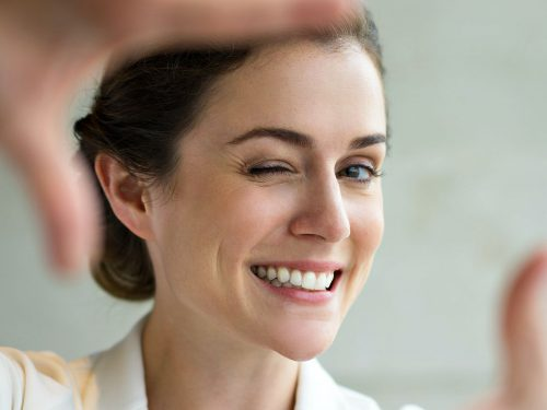 closeup-smiling-woman-making-frame-gesture-argireline-ss-Featured